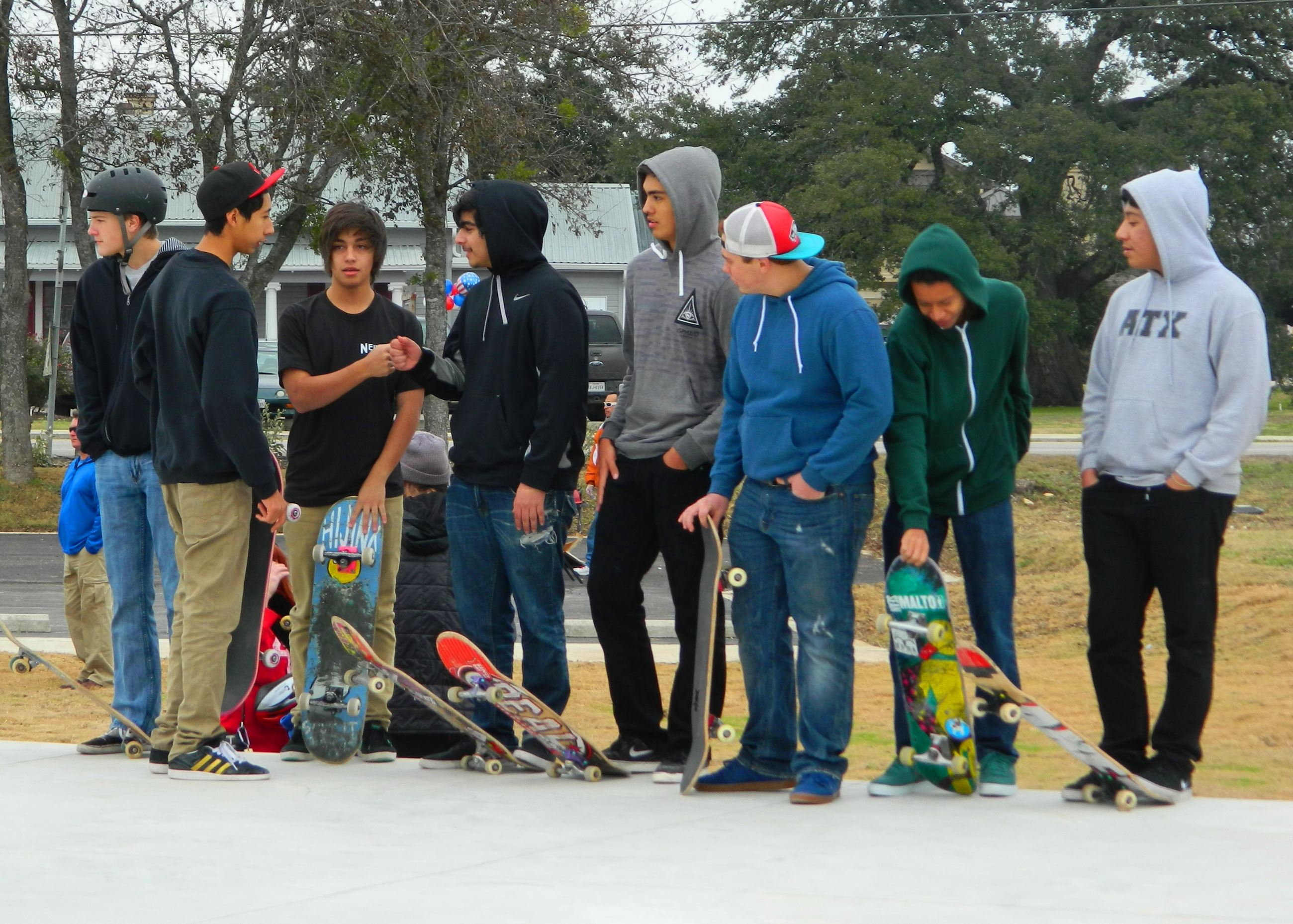 Boys waiting for turn to skate