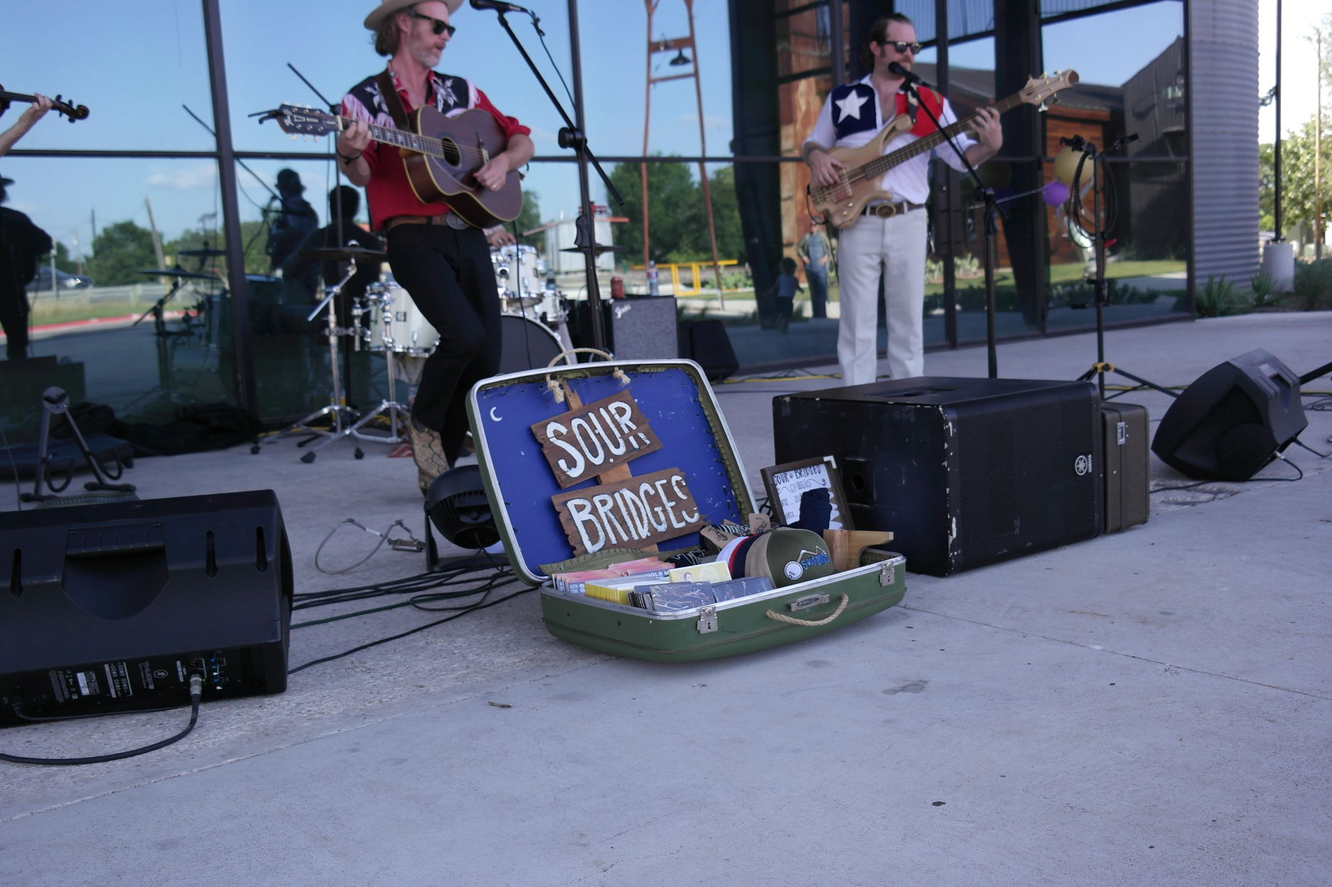 Band performing at the Buda Mill and Grain in front of the Big 'Un