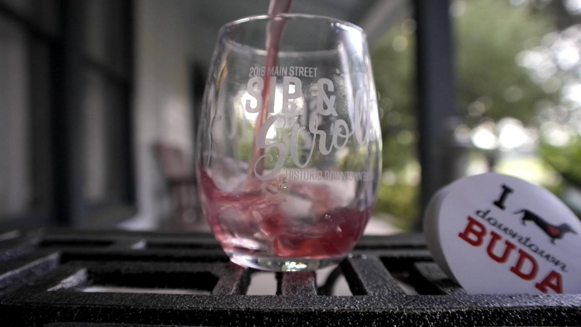 Wine being poured into glass from the Buda Sip and Stroll