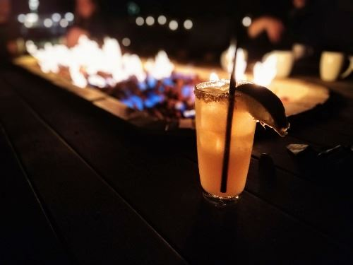 House margarita in front of fire at Nate's in Buda, TX