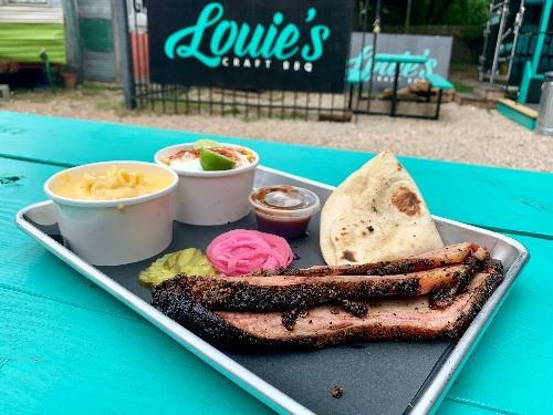 Loui's Brisket plate with elote and mac and cheese