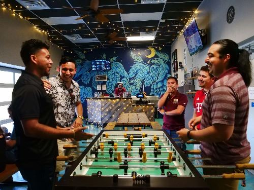 Guys playing Foosball at Two Wheel