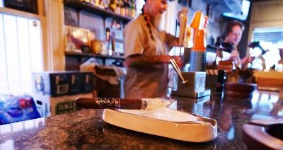 Lit Cigar resting at the Cigar Vault