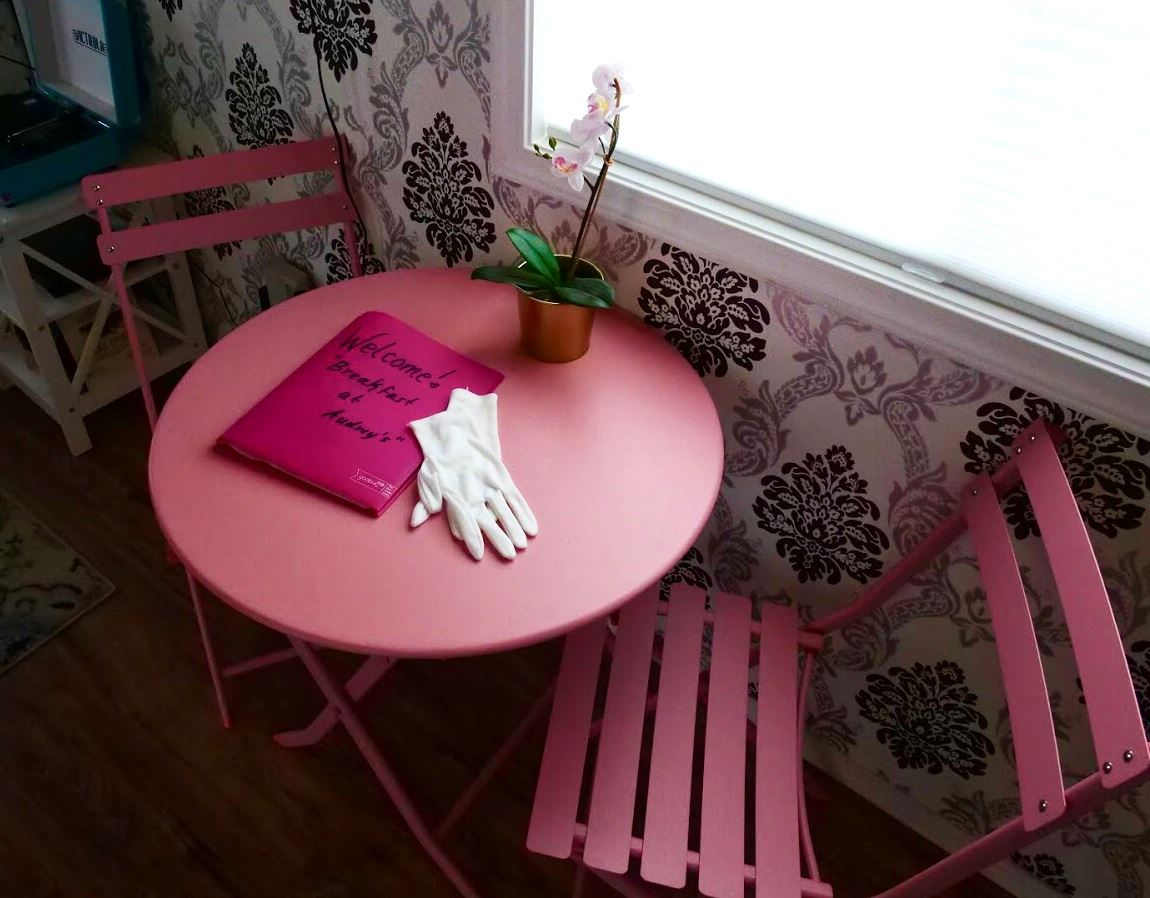 Table and chairs in Audrey Hepburn themed tiny home at Docs Drive-In Theatre