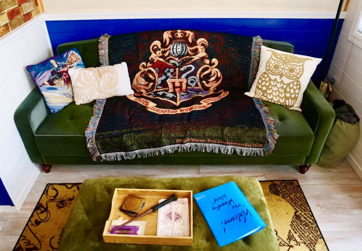 Couch in Harry Potter themed tiny home at Docs Drive-In Theatre