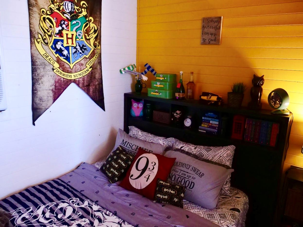 Bed in Harry Potter themed tiny home at Docs Drive-In Theatre