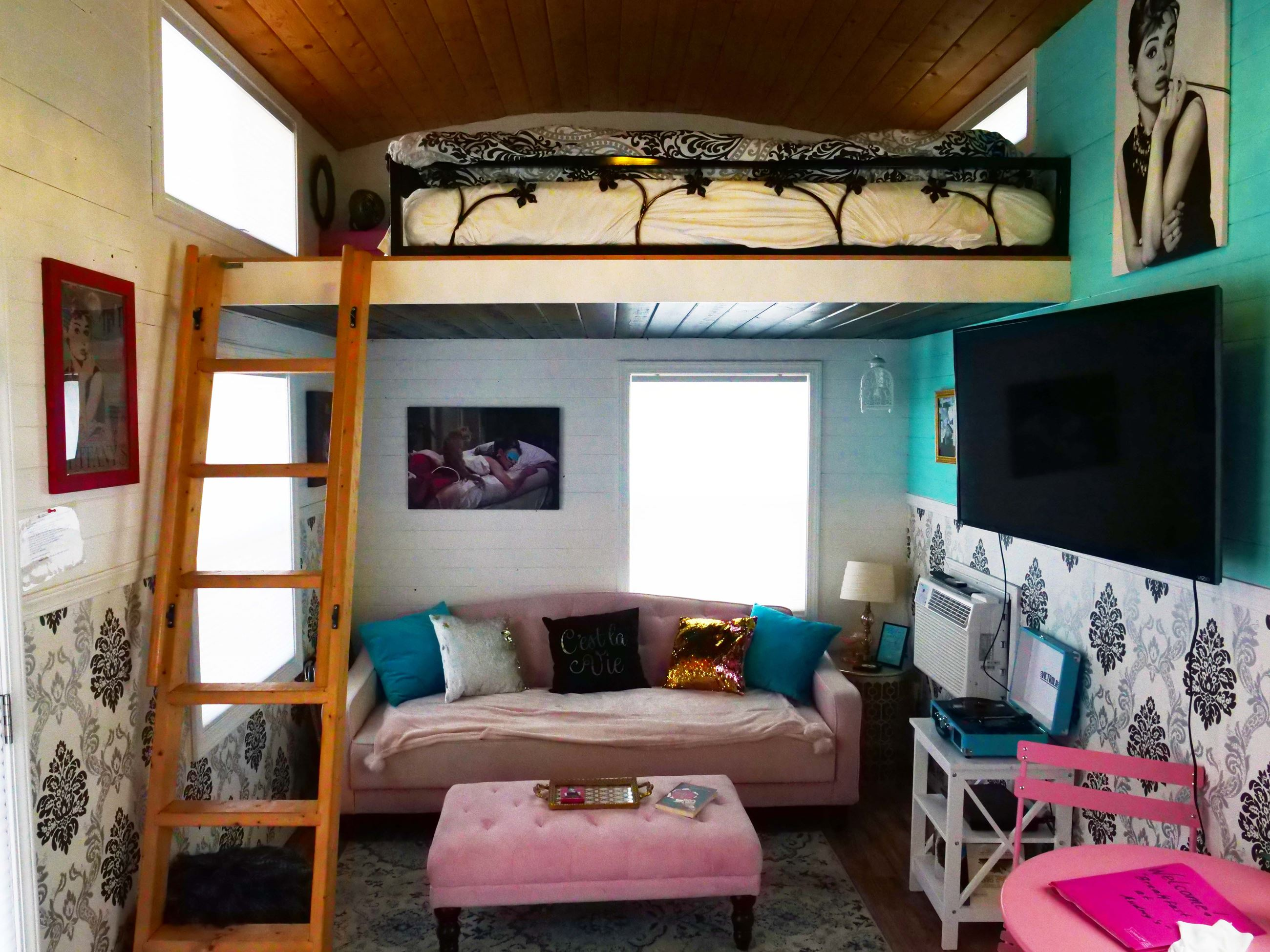 Couch and Bed at Audrey Hepburn themed tiny home at Docs Drive-In Theatre