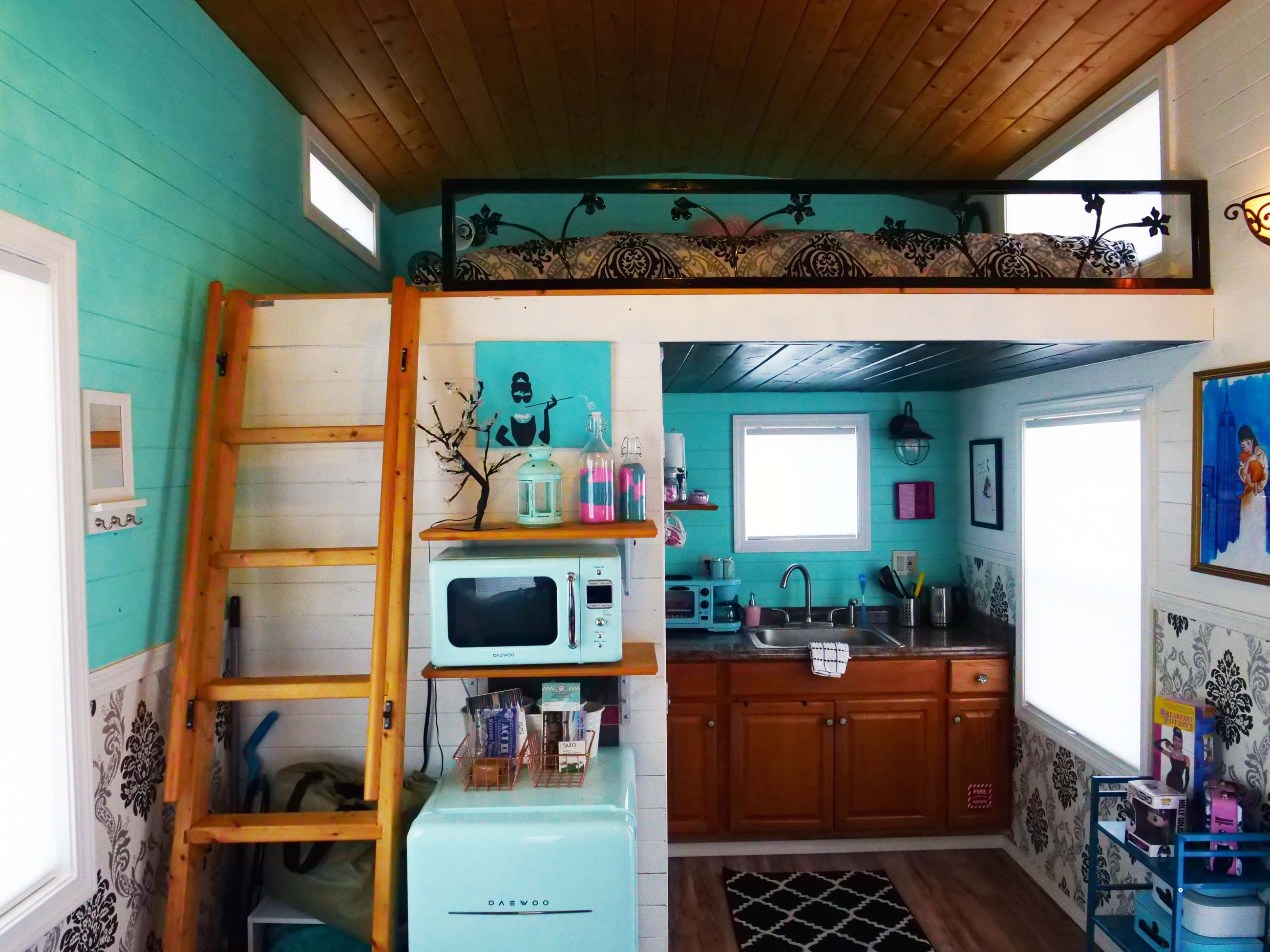 Kitchen and Bed at Audrey Hepburn themed tiny home at Docs Drive-In Theatre